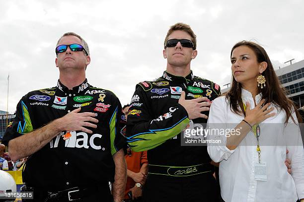 Carl Edwards driver of the Aflac Ford stands with his wife Kate and crew chief Bob Osborne on the grid prior to the NASCAR Sprint Cup Series AAA...