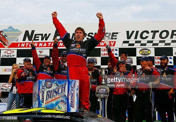 Carl Edwards driver of the Ameriquest Ford celebrates his win in victory lane with his crew members following the NASCAR Busch Series New England 200...
