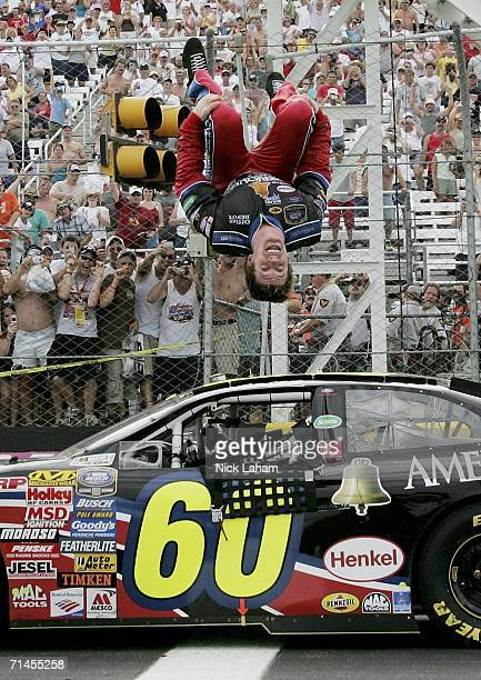 Carl Edwards driver of the Ameriquest Ford celebrates his win with a backflip on the track following the NASCAR Busch Series New England 200 on July...