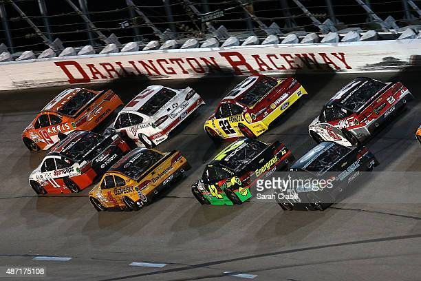 Carl Edwards driver of the ARRIS Toyota leads a pack of cars during the NASCAR Sprint Cup Series Bojangles' Southern 500 at Darlington Raceway on...