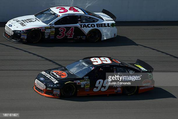 Carl Edwards driver of the Best Buy Geek Squad / Fastenal Ford and David Ragan driver of the Taco Bell Ford during the NASCAR Sprint Cup Series 44th...