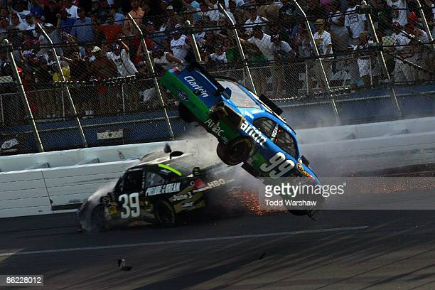 Carl Edwards, driver of the Claritin Ford goes airborne as Ryan Newman, driver of the Stewart-Haas Racing Chevrolet hits the wall at the end of the...