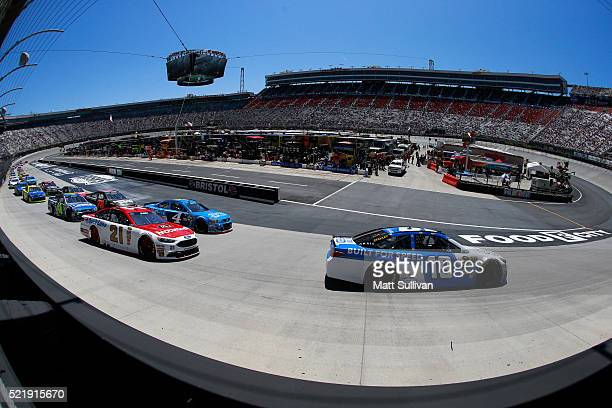 Carl Edwards driver of the Comcast Business Toyota leads a pack of cars during the NASCAR Sprint Cup Series Food City 500 at Bristol Motor Speedway...