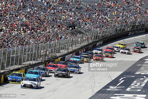 Carl Edwards driver of the Comcast Business Toyota leads the field during the NASCAR Sprint Cup Series Food City 500 at Bristol Motor Speedway on...