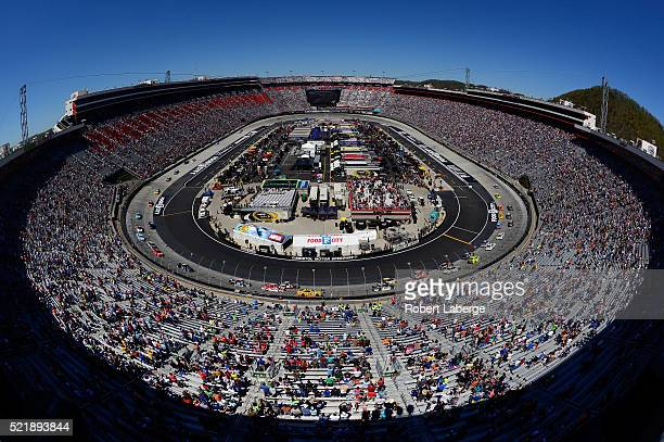 Carl Edwards driver of the Comcast Business Toyota leads the past the green flag to start the NASCAR Sprint Cup Series Food City 500 at Bristol Motor...
