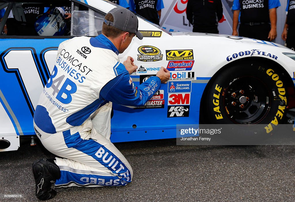 Carl Edwards, driver of the #19 Comcast Business Toyota, places the Coors Light Pole Award decal on his car after qualifying for the pole position for the NASCAR Sprint Cup Series Bad Boy Off Road 300 at New Hampshire Motor Speedway on September 23, 2016 in Loudon, New Hampshire.
