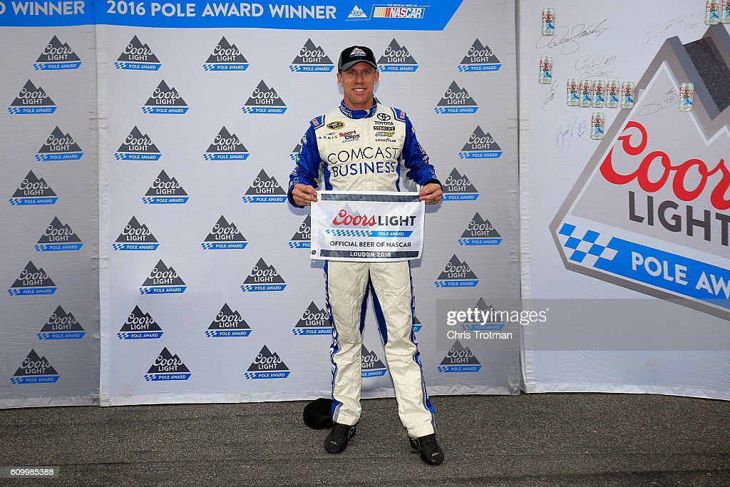 Carl Edwards, driver of the #19 Comcast Business Toyota, poses with the Coors Light Pole Award after qualifying for the pole position for the NASCAR Sprint Cup Series Bad Boy Off Road 300 at New Hampshire Motor Speedway on September 23, 2016 in Loudon, New Hampshire.