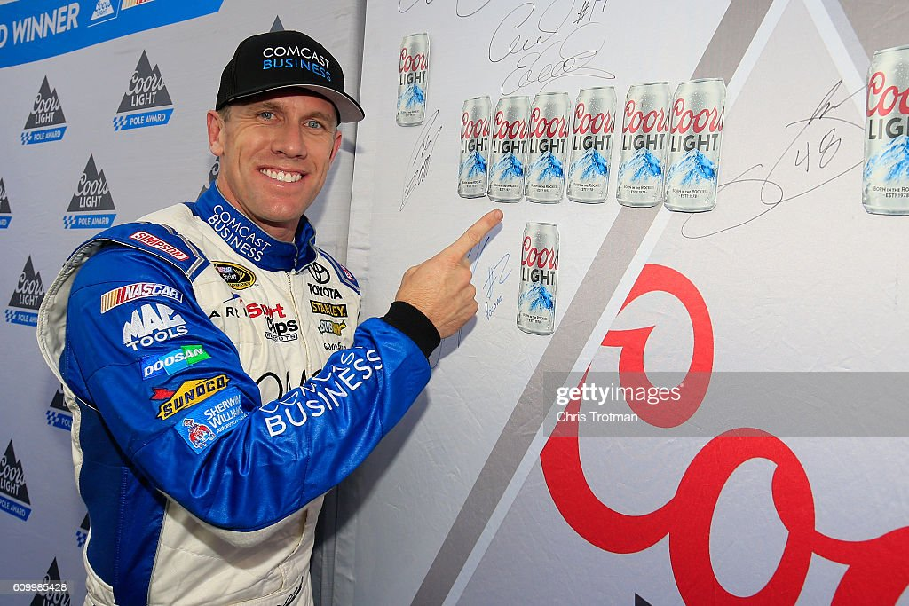 Carl Edwards, driver of the #19 Comcast Business Toyota, poses with the Coors Light Pole board after qualifying for the pole position for the NASCAR Sprint Cup Series Bad Boy Off Road 300 at New Hampshire Motor Speedway on September 23, 2016 in Loudon, New Hampshire.