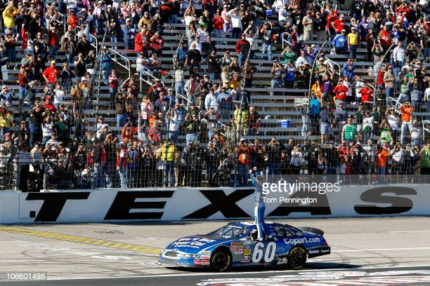 Carl Edwards driver of the Copartcom Ford celebrates after winning the NASCAR Nationwide Series O'Reilly Auto Parts Challenge at Texas Motor Speedway...