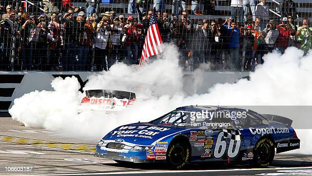 Carl Edwards driver of the Copartcom Ford celebrates finishing first finish in the NASCAR Nationwide Series O'Reilly Auto Parts Challenge as Brad...