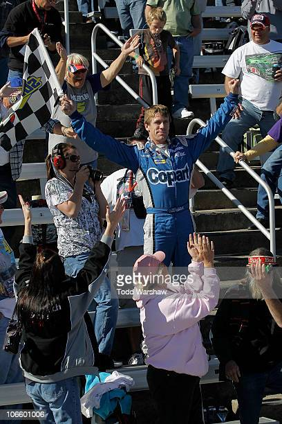 Carl Edwards driver of the Copartcom Ford celebrates in the stands after winning the NASCAR Nationwide Series O'Reilly Auto Parts Challenge at Texas...