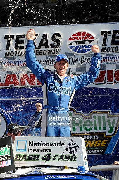 Carl Edwards driver of the Copartcom Ford celebrates in Victory Lane after winning the NASCAR Nationwide Series O'Reilly Auto Parts Challenge at...
