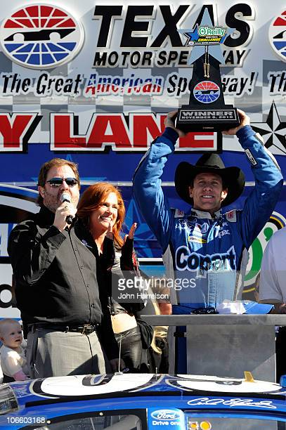 Carl Edwards driver of the Copartcom Ford celebrates with Texas Motor Speedway President Eddie Gossage in Victory Lane after winning the NASCAR...