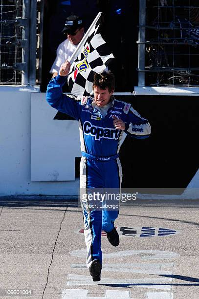 Carl Edwards driver of the Copartcom Ford celebrates with the checkered flag after winning the NASCAR Nationwide Series O'Reilly Auto Parts Challenge...