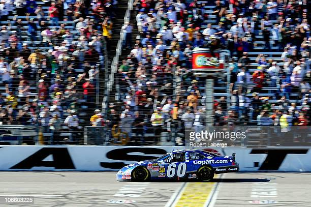 Carl Edwards driver of the Copartcom Ford crosses the finish line to win the NASCAR Nationwide Series O'Reilly Auto Parts Challenge at Texas Motor...