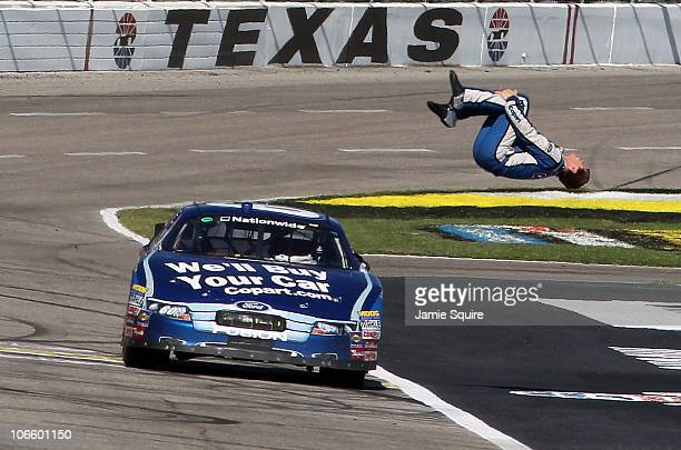 Carl Edwards driver of the Copartcom Ford does a back flip as he celebrates after winning the NASCAR Nationwide Series O'Reilly Auto Parts Challenge...