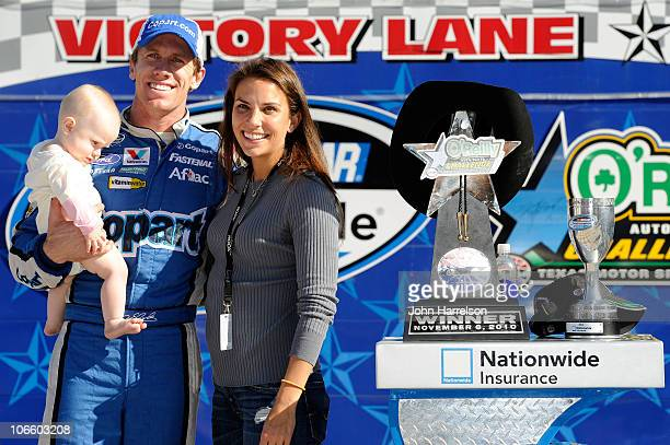 Carl Edwards driver of the Copartcom Ford holds his daughter Anne with his wife Kate in Victory Lane after winning the NASCAR Nationwide Series...