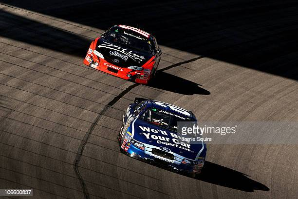 Carl Edwards driver of the Copartcom Ford leads Kyle Busch driver of the ZLine Designs Toyota during the NASCAR Nationwide Series O'Reilly Auto Parts...