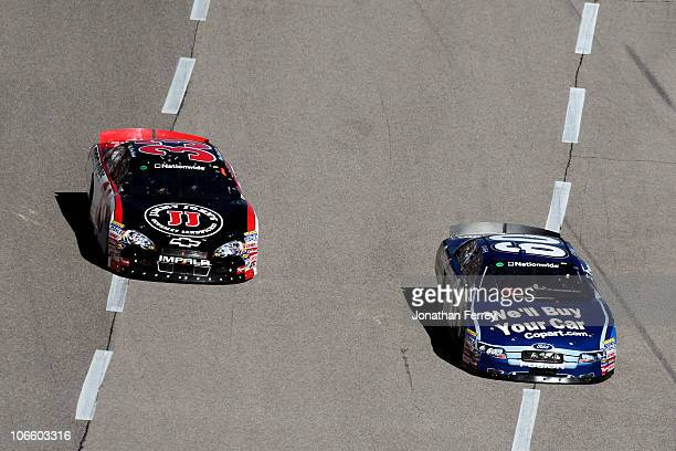 Carl Edwards driver of the Copartcom Ford races Kevin Harvick driver of the Jimmy John's Chevrolet during the NASCAR Nationwide Series O'Reilly Auto...