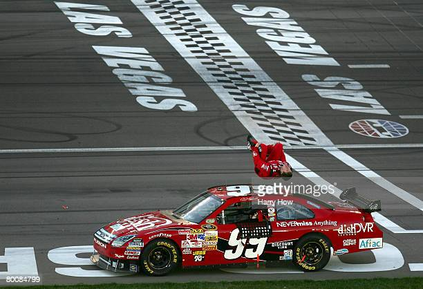 Carl Edwards driver of the Dish Network Ford celebrates with a back flip after winning the NASCAR Sprint Cup Series UAWDodge 400 at the Las Vegas...