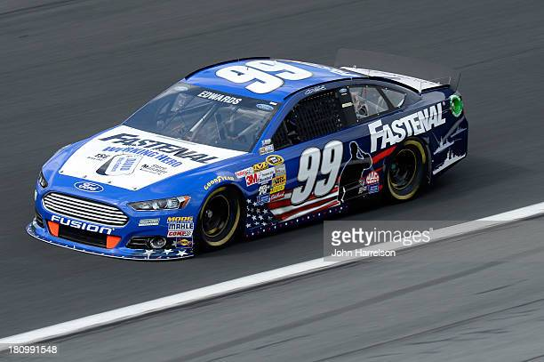 Carl Edwards driver of the Fastenal Ford during practice for the NASCAR Sprint Cup Series CocaCola 600 at Charlotte Motor Speedway on May 23 2013 in...