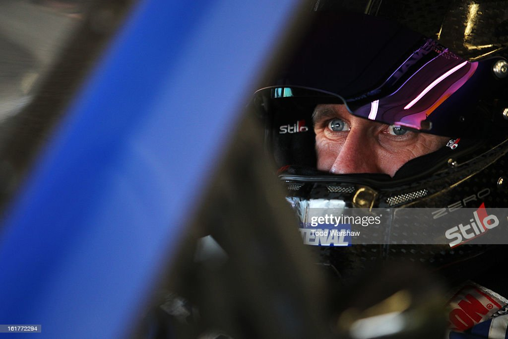 Carl Edwards, driver of the #99 Fastenal Ford, looks on during practice for the NASCAR Sprint Cup Series Sprint Unlimited at Daytona International Speedway on February 15, 2013 in Daytona Beach, Florida.