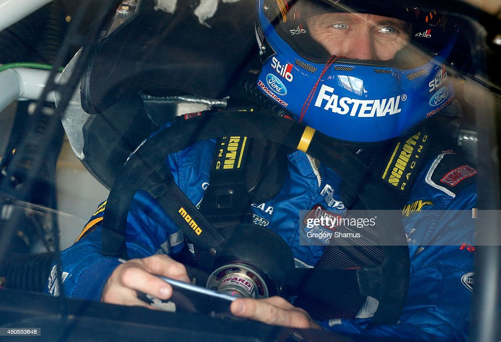 Carl Edwards, driver of the #99 Fastenal Ford, sits in his car during practice for the NASCAR Sprint Cup Series Quicken Loans 400 at Michigan International Speedway on June 13, 2014 in Brooklyn, Michigan.