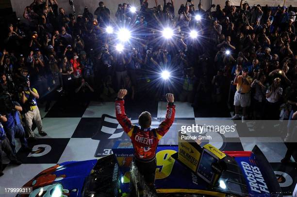 Carl Edwards driver of the Kellogg's / CheezIt Ford celebrates in Victory Lane after winning the NASCAR Sprint Cup Series 56th Annual Federated Auto...