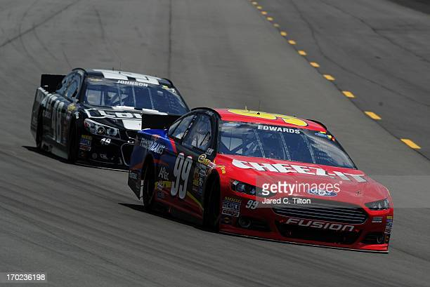 Carl Edwards driver of the Kellogg's/CheezIt Ford leads Jimmie Johnson driver of the Lowe's/Kobalt Tools Chevrolet during the NASCAR Sprint Cup...