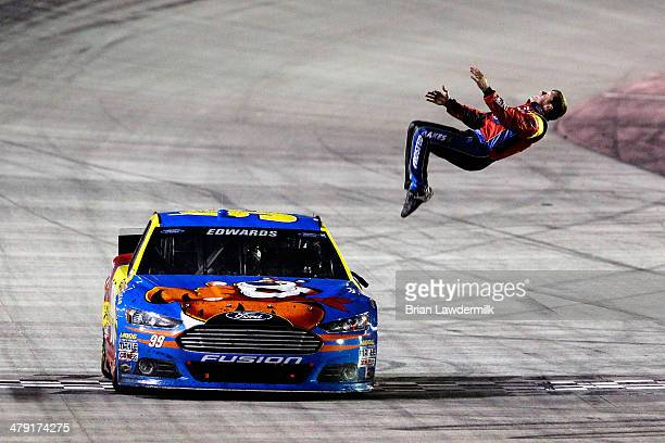 Carl Edwards, driver of the Kellogg's/Frosted Flakes Ford, celebrates with a backflip after winning the NASCAR Sprint Cup Series Food City 500 at...