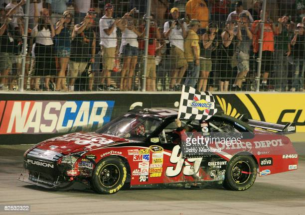 Carl Edwards driver of the Office Depot Ford celebrates winning the NASCAR Sprint Cup Series Sharpie 500 at Bristol Motor Speedway on August 23 2008...