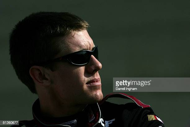 Carl Edwards driver of the Roush Racing Ford looks on during practice for the NASCAR Nextel Cup Series Pop Secret 500 on September 3 2004 at...