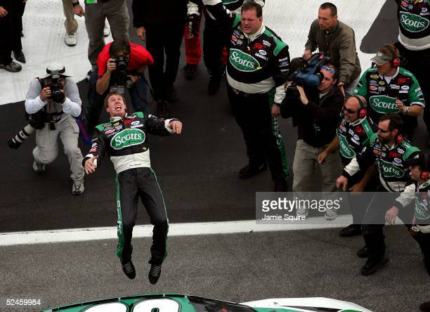 Carl Edwards driver of the Roush Racing Ford performs a backflip after winning the NASCAR Nextel Cup Golden Corral 500 on March 20 2005 at the...