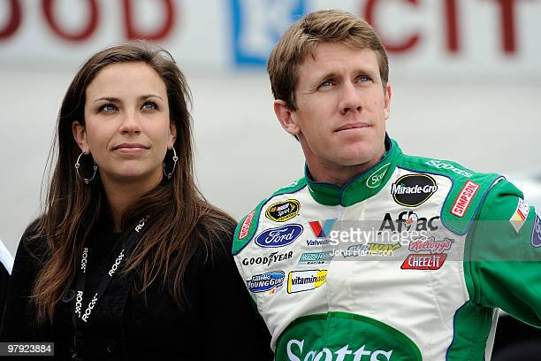 Carl Edwards driver of the Scotts Ford stands with his wife Kate prior to the NASCAR Sprint Cup Series Food City 500 at Bristol Motor Speedway on...