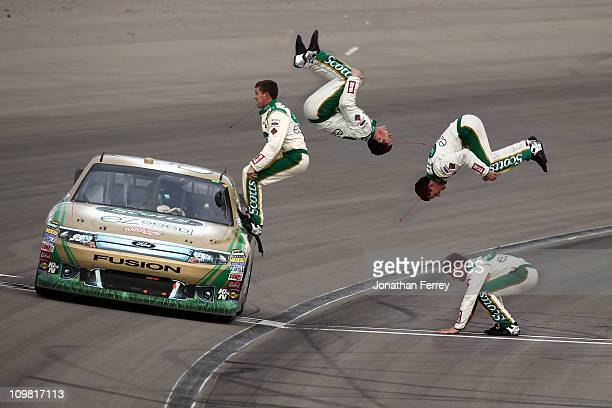 Carl Edwards driver of the Scotts/Kellogg's Ford celebrates with a flip from his car after winning the NASCAR Sprint Cup Series Kobalt Tools 400 at...