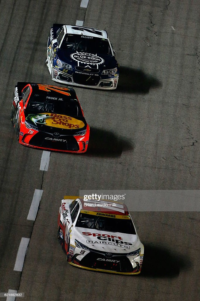 Carl Edwards, driver of the #19 Sport Clips Toyota, leads Martin Truex Jr., driver of the #78 Bass Pro Shops/TRACKER Boats Toyota, and Chase Elliott, driver of the #24 Kelley Blue Book Chevrolet, during the NASCAR Sprint Cup Series AAA Texas 500 at Texas Motor Speedway on November 6, 2016 in Fort Worth, Texas.