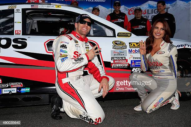 Carl Edwards driver of the Sport Clips Toyota poses with Miss Coors Light Amanda Mertz and the Coors Light Pole Award decal after qualifying on the...