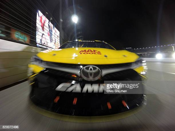 Carl Edwards driver of the Stanley Toyota leads the field at the start of the NASCAR Sprint Cup Series Duck Commander 500 at Texas Motor Speedway on...
