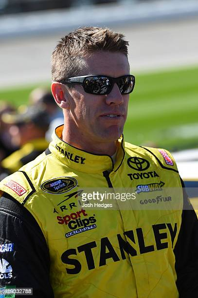 Carl Edwards driver of the STANLEY Toyota walks on the grid prior to the NASCAR Sprint Cup Series myAFibRiskcom 400 at Chicagoland Speedway on...