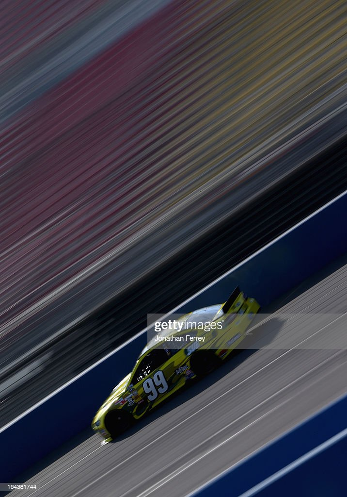 Carl Edwards, driver of the #99 Subway Ford, practices for the NASCAR Sprint Cup Series Auto Club 400 at Auto Club Speedway on March 23, 2013 in Fontana, California.