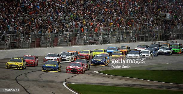 Carl Edwards driver of the Subway Ford Ricky Stenhouse Jr driver of the Best Buy Ford and Juan Pablo Montoya driver of the Target Chevrolet lead the...