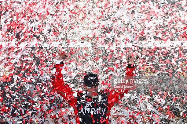 Carl Edwards driver of the XFINITY Toyota celebrates in Victory Lane after winning the NASCAR Sprint Cup Series TOYOTA OWNERS 400 at Richmond...