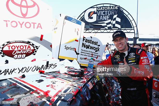 Carl Edwards driver of the XFINITY Toyota poses with the winner's decal after winning the NASCAR Sprint Cup Series TOYOTA OWNERS 400 at Richmond...