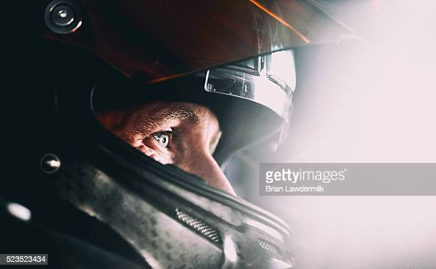 Carl Edwards driver of the XFINITY Toyota sits in his car during practice for the NASCAR Sprint Cup Series TOYOTA OWNERS 400 at Richmond...