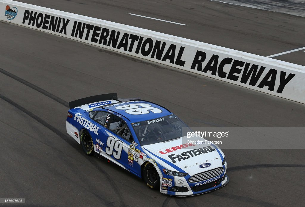 Carl Edwards drives the #99 Fastenal Ford as he runs out of gas after Kevin Harvick, driver of the #29 Budweiser Chevrolet, corssed the finish line to win the NASCAR Sprint Cup Series AdvoCare 500 at Phoenix International Raceway on November 10, 2013 in Avondale, Arizona.