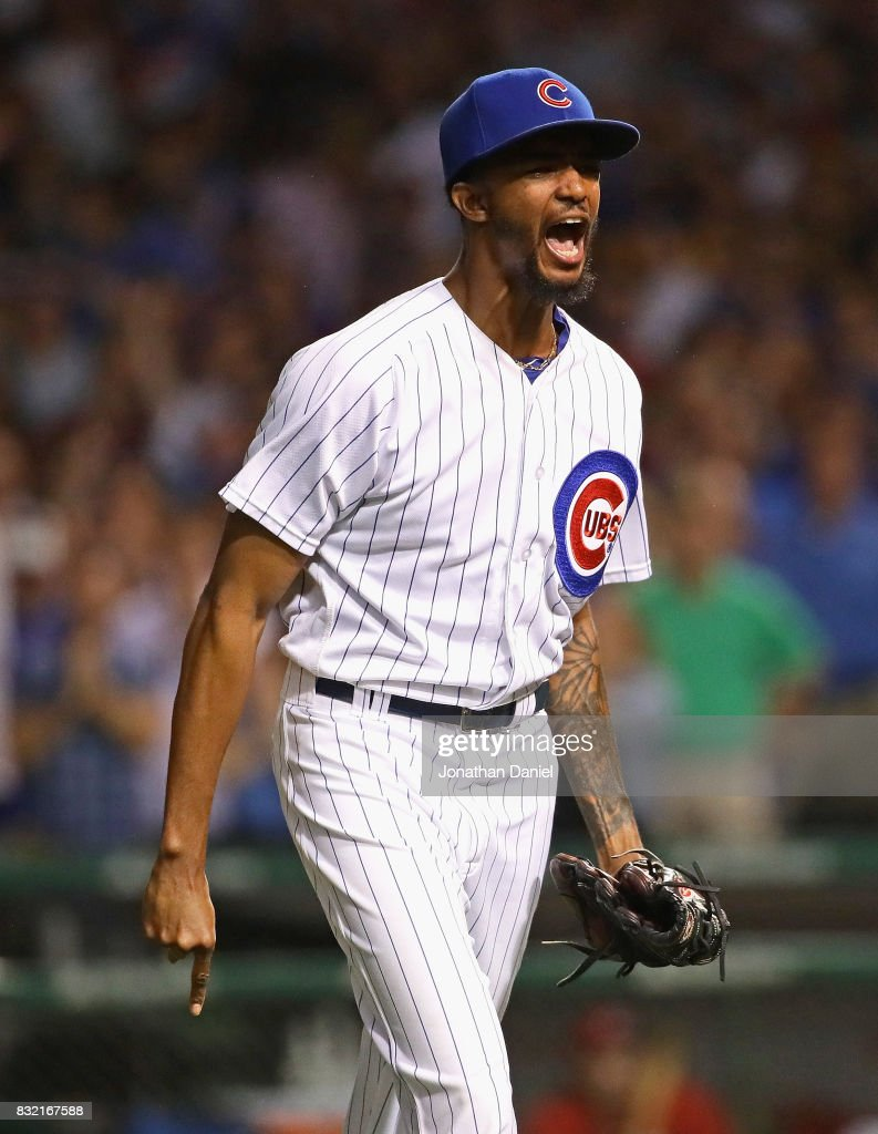 Carl Edwards Jr. #6 of the Chicago Cubs celebrates after getting three strikeouts with men on base to end the Cincinnati Reds half of the 7th inning at Wrigley Field on August 15, 2017 in Chicago, Illinois.