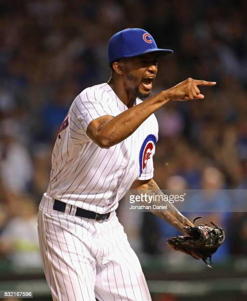 Carl Edwards Jr #6 of the Chicago Cubs celebrates after getting three strikeouts with men on base to end the Cincinnati Reds half of the 7th inning...