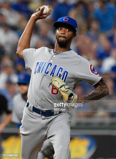 Carl Edwards Jr #6 of the Chicago Cubs throws to first on a pick off attempt on Adalberto Mondesi of the Kansas City Royals in the seventh inning at...
