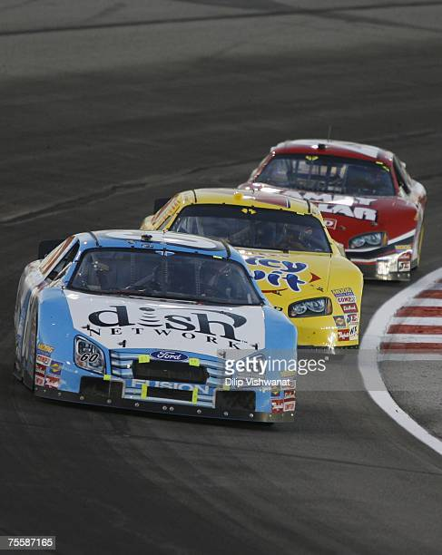Carl Edwards of the Dish Network Ford leads Reed Sorenson of the Wrigley's Juicy Fruit Dodge and Mike Bliss of the Family Dollar Dodge during the...