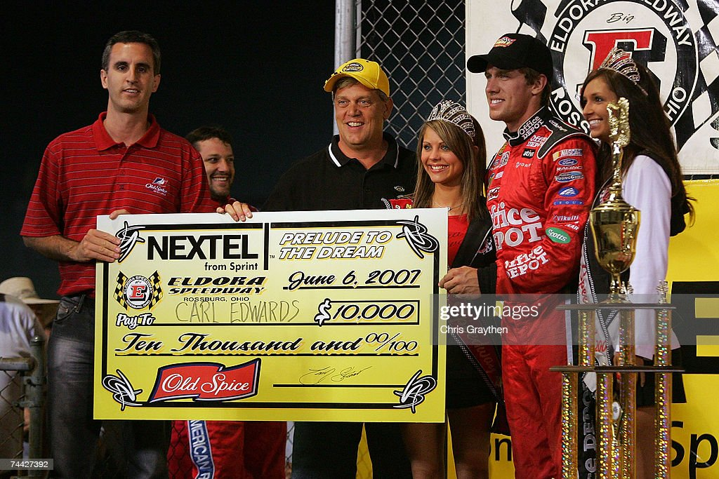 Carl Edwards (2R) receives a check for winning the Nextel Prelude to the Dream on June 6, 2007 at Eldora Speedway in New Weston, Ohio.